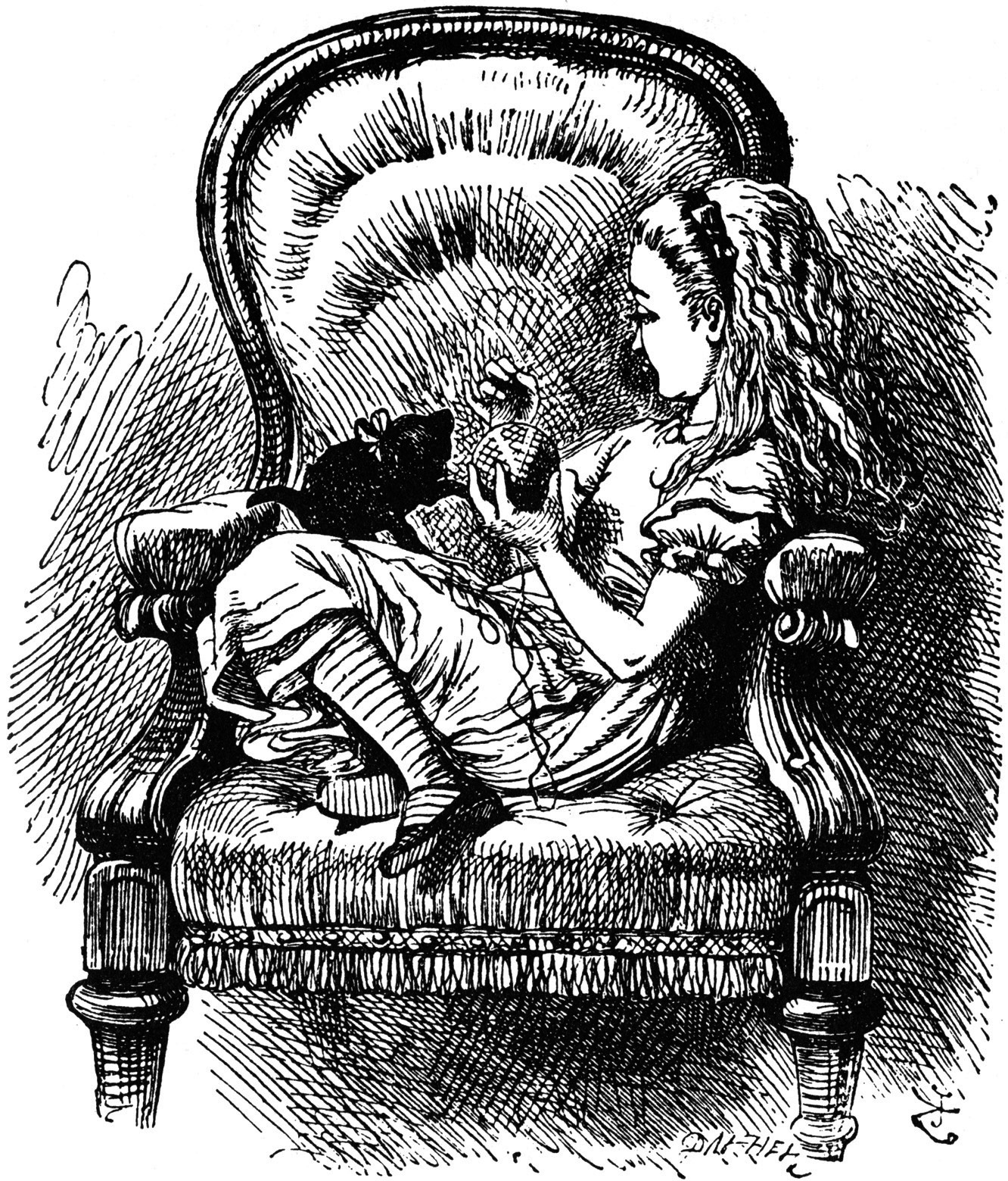 Alice sitting in a chair with her kitten