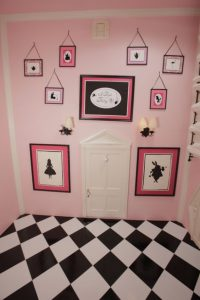 Alice paintings and checkered floor